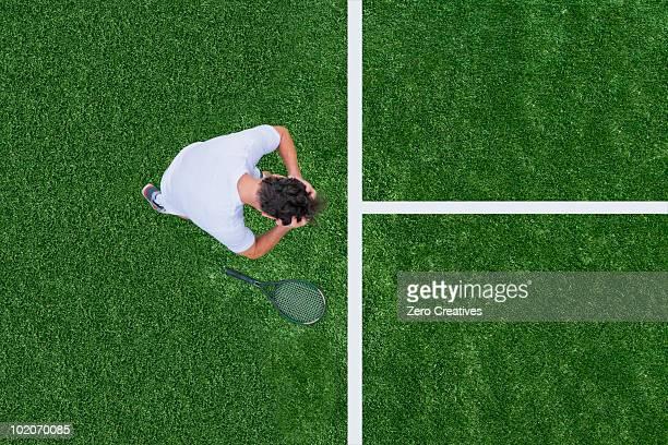 Man losing tennis match