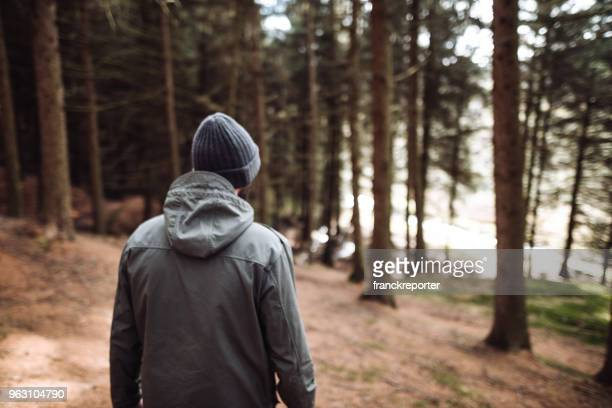 man lost in the forest walking alone
