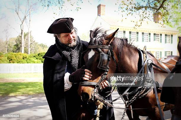 man loving horse team. - williamsburg virginia stock pictures, royalty-free photos & images