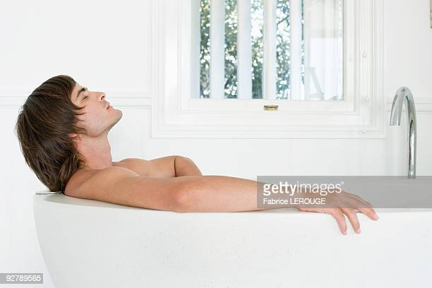 Man lying in a bathtub