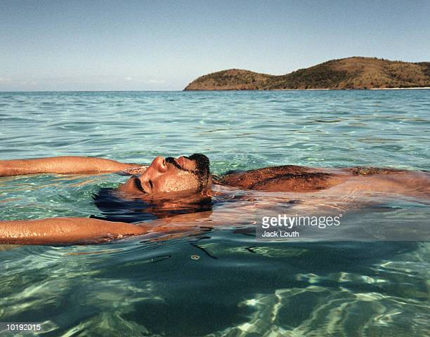 man lying in clear ocean water, puerto rico - one mid adult man only stock pictures, royalty-free photos & images