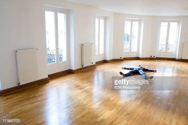 Man lying in empty room