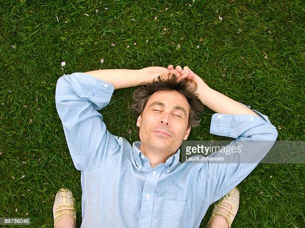 Man lying in grass, Central Park