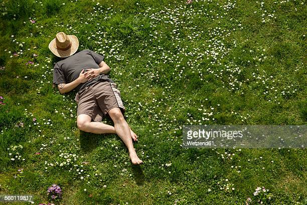 Man lying in grass relaxing