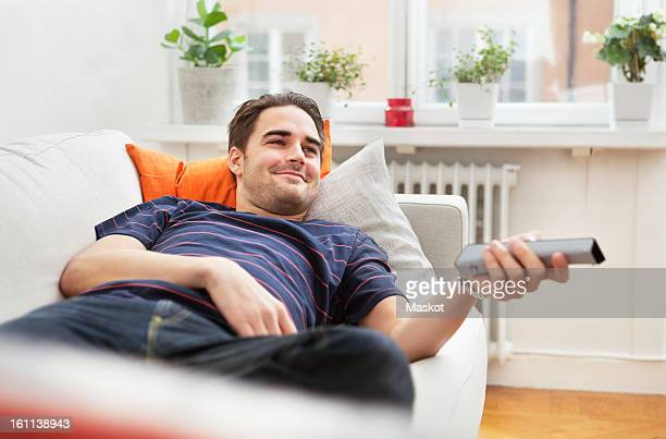 Man lying in sofa