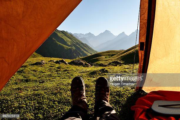 Man lying in tent, looking at view, Caucasus, Svaneti, Georgia