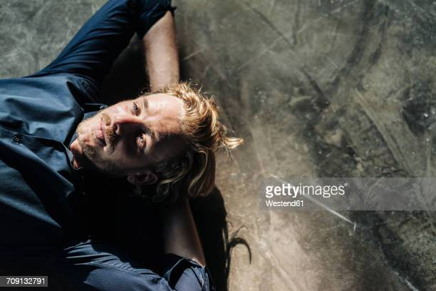 man lying on floor looking up - resting stock pictures, royalty-free photos & images