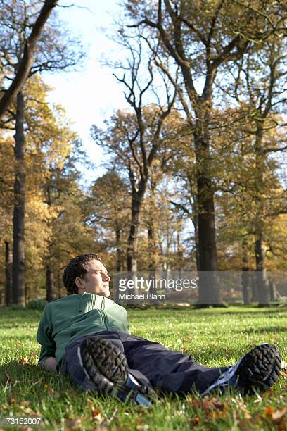 Man lying on grass, relaxing in park