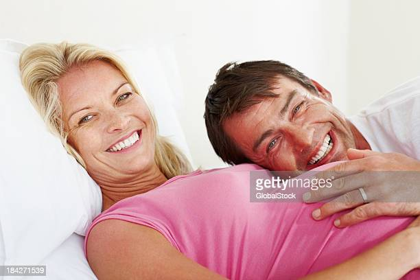 Man lying on pregnant woman's tummy