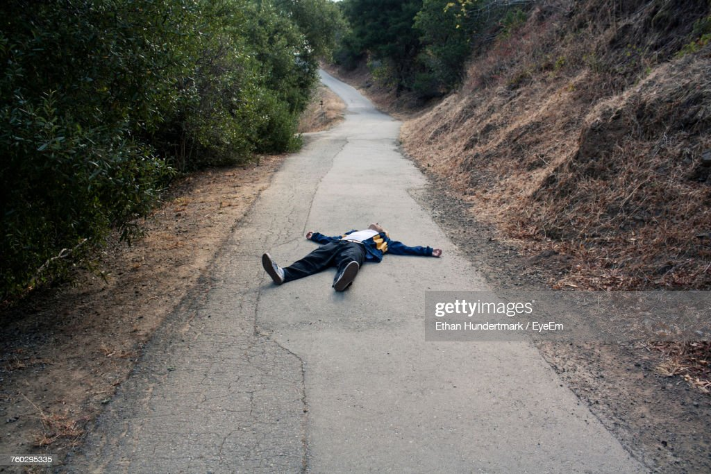 Man Lying On Road : Stock Photo