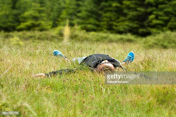 man lying on the grass facing the sky