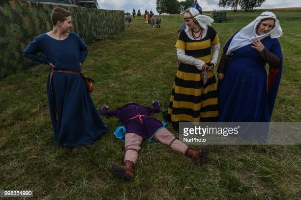 Man lying on the grass is seen in Grunwald Poland on 13 July 2018 Battle of Grunwald reenactment participants take part in the last rehearsal dressed...
