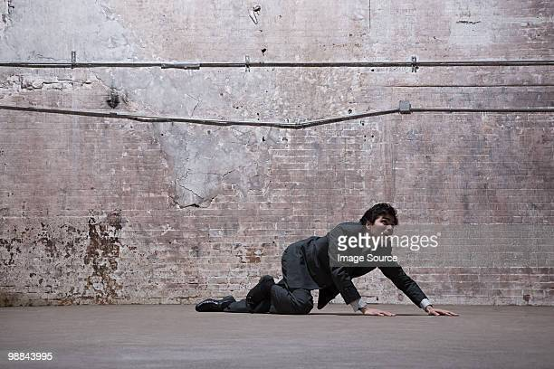 Man lying on warehouse floor