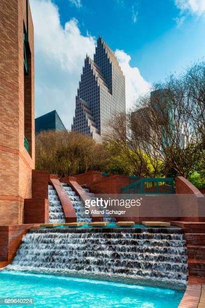 man made waterfall in park in downtown houston texas - houston stock pictures, royalty-free photos & images