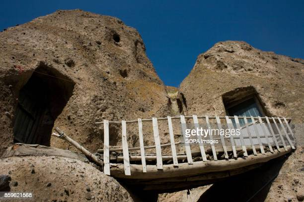 A man made wood bridge is seen use to reach a local house The tiny village of Kandovan in the Iranian East Azerbaijan Province is known for its cliff...
