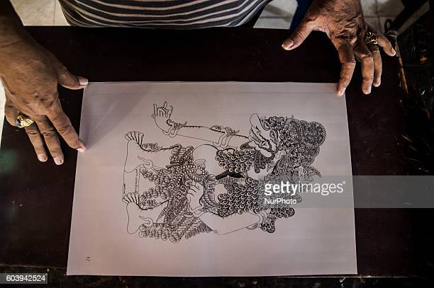 A man make shadow puppet known as ' wayang ' in Yogyakarta Indonesia on September 13 2016 Shadow puppet has been recognized as a world cultural...