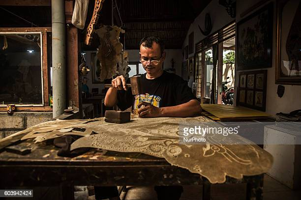 A man make shadow puppet known as ' wayang ' in Yogyakarta Indonesia on September 7 2016 Shadow puppet has been recognized as a world cultural...