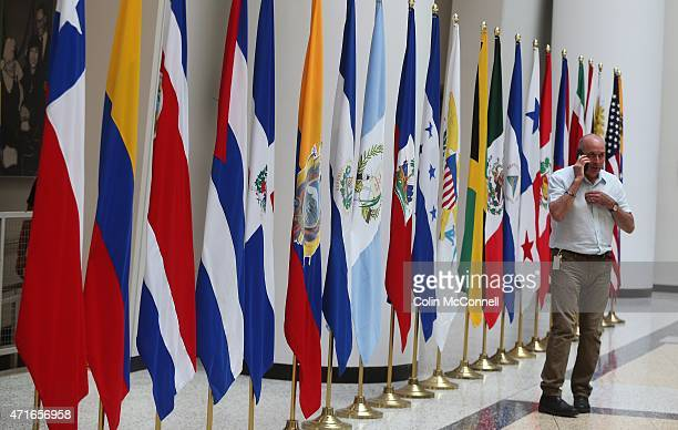 Man makes a call in front of the PanAm flags... Launch event held at the CBC on Front St for the 100 days to ParaPan with speakers and a...