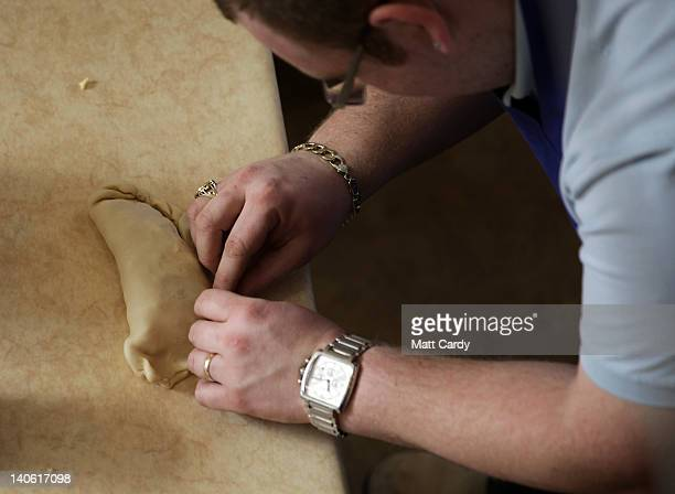 Man makes a Cornish pasty in a pasty making workshop as part of the World Cornish Pasty Championships at The Eden Project on March 3, 2012 in St...