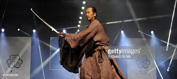 A man makes a demonstration with a katana saber during the fashion show of FrenchJapan fashion design company Aoi Clothing at the Japan Expo 2015 on...