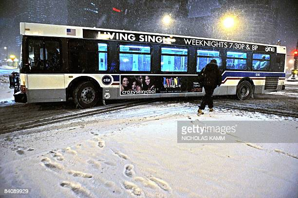 A man makes his way across a street during a snow storm in Chicago early December 19 2008 Up to 30cm of snow was expected to fall overnight AFP...