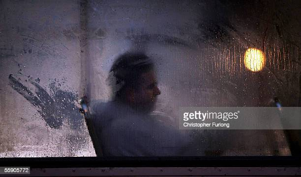 A man makes his way home from work on a bus as darkness falls on October 10 2005 in Glasgow Scotland Seasonal affective disorder or winter depression...