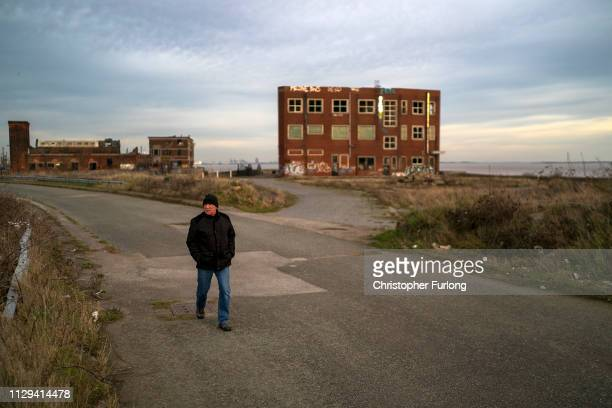 Man makes his way home through a derelict dockyard on February 13, 2019 in Hull, England.