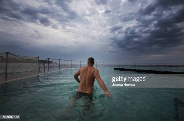 A man makes his way into Bronte ocean swimming pool at Bronte Beach on another hot and steamy morning on December 16 2017 in Sydney Australia Sydney...