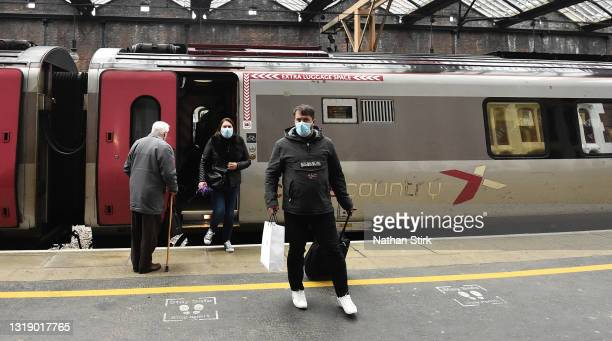 Man makes his way off a Arriva Cross Country Train at Stoke-on-Trent Train Station on May 20, 2021 in Stoke, England. The British government has...