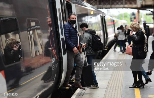 Man makes his way off a Avanti West Coast Train at Stoke-on-Trent Train Station on May 20, 2021 in Stoke, England. The British government has created...