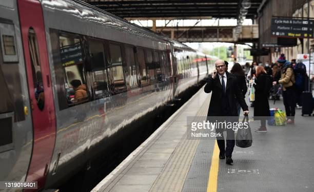 Man makes his way onto a Cross Country Train at Stoke-on-Trent Train Station on May 20, 2021 in Stoke, England. The British government has created a...