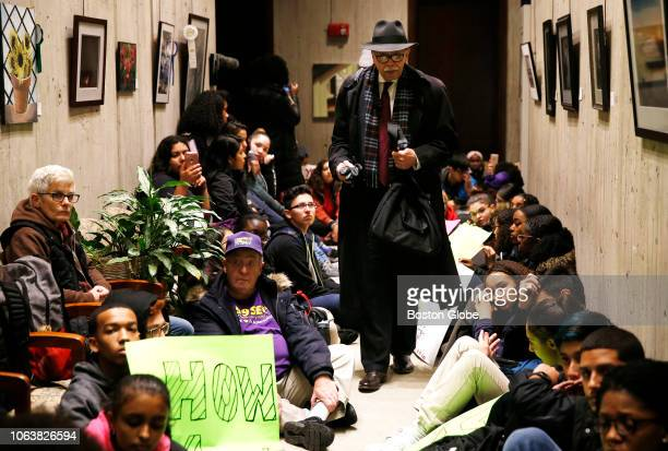 A man makes his way through students protesting in the hallway of the Mayor's Office at Boston City Hall on Nov 19 2018 About 100 teenagers from...