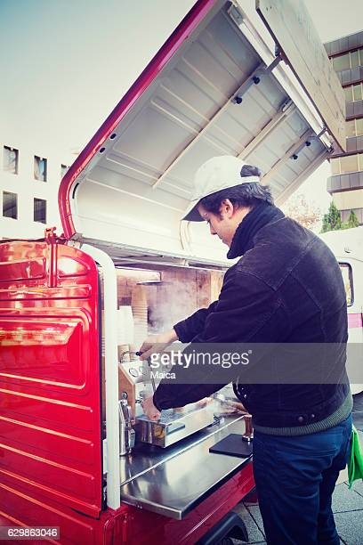 Man making a coffee in food truck