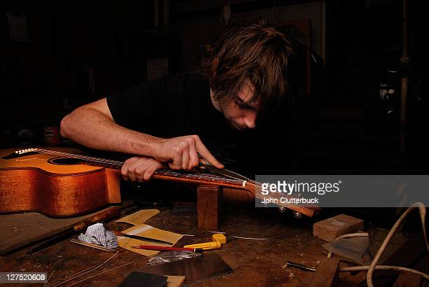 man making a guitar - instrument maker stock photos and pictures