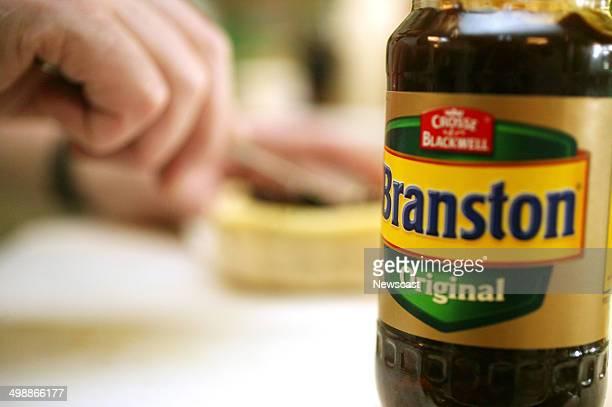 A man making a sandwich using Branston Original Pickle a Premier Foods brand