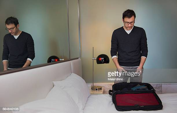 Man making a suitcase
