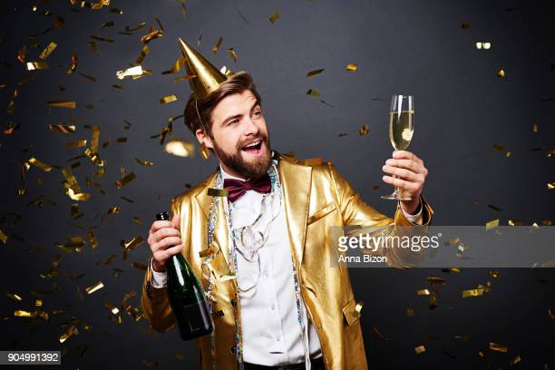 Man making a toast to new year. Debica, Poland