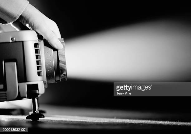 Man making adjustments to digital projector (B&W)