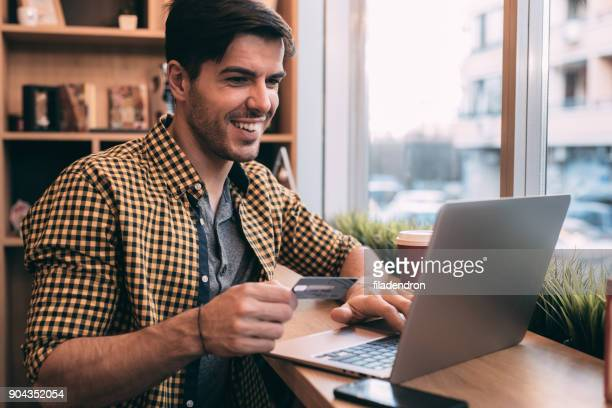 man making an onlline payment - money transfer stock pictures, royalty-free photos & images