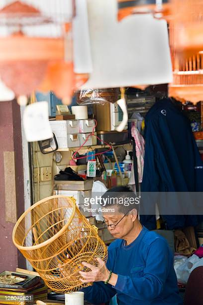man making bird cages, bird market, hong kong, china - peter adams stock pictures, royalty-free photos & images