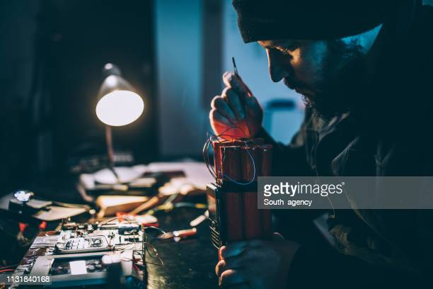 man making bomb - terrorism stock pictures, royalty-free photos & images