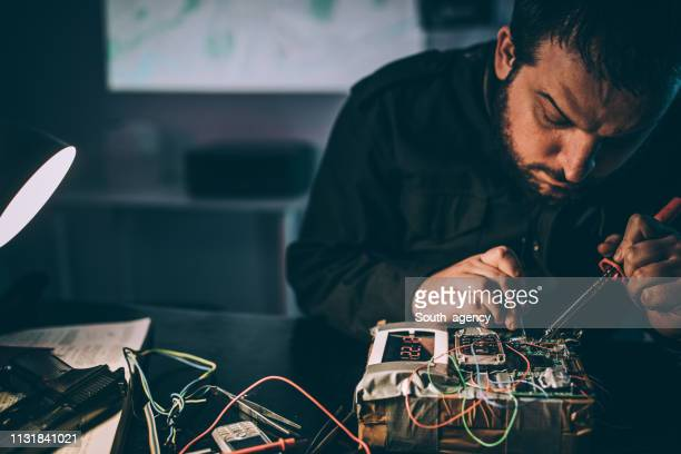 man making bomb - detonator stock photos and pictures
