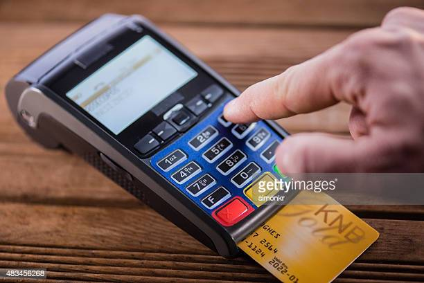 Man making credit card payment