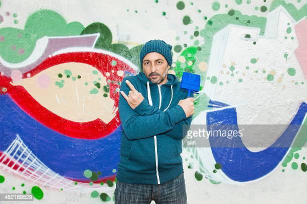 Man making gang signs