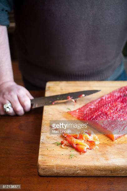 Man making gravlax
