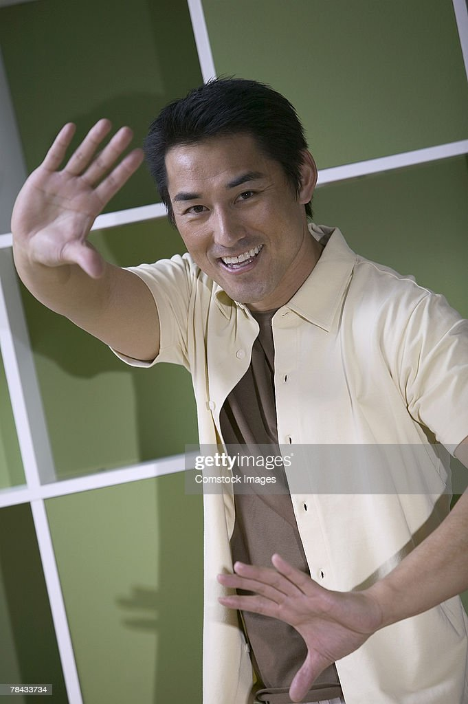Man making hand gesture : Stockfoto