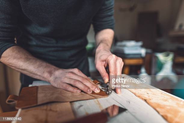 man making leather purse - leather purse stock pictures, royalty-free photos & images