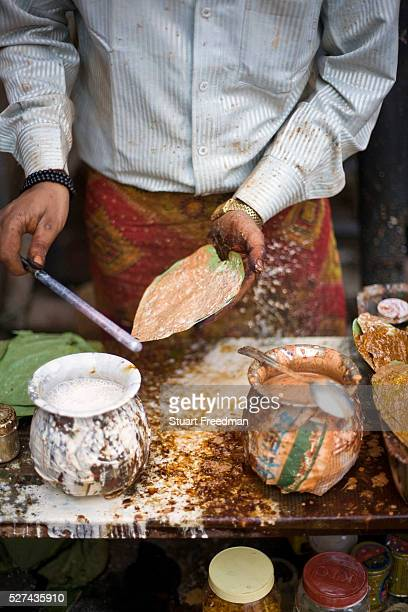 A man making paan in the Bapu bazaar Jaipur India Paan consists of chewing Betel leaf combined with the areca nut It is chewed as a palate cleanser...