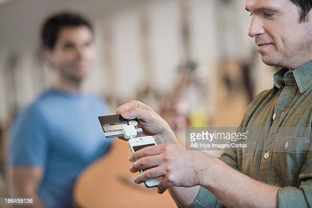 Man making payment using credit card and smartphone