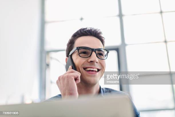 man making phonecall using mobile phone - focus on background stock pictures, royalty-free photos & images